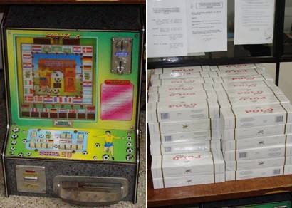 PM apreende 115 caixas de cigarros falsificados e um caça-níquel